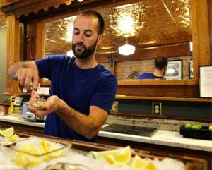 Drayton Harbor Oyster Company's Pacific Oysters are served up by co-owner Mark Seymour. Photo courtesy: Steve Seymour.