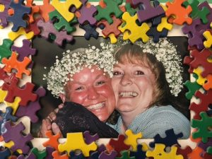 Jody Guenser and Pam Sinnett pictured in 2000 at a fund raiser before the end of another successful school year. Photo credit: Dondi Tondro-Smith.