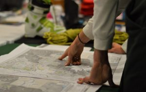 An attendee at the Recreation Northwest 2016 EXPO explored hiking areas on a map of Washington state. Photo credit: Todd Ellsworth.