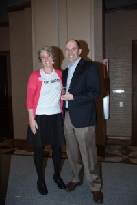 United Way of Whatcom County's Community Engagement Manager, Kristi Birkeland, presented Barry Hanson from HUB Northwest with the Company Achievement Award.