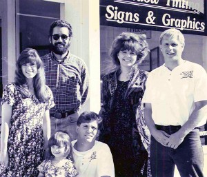 The Signs Plus team circa 1994 pose for a photo in front of the shop's original location at 1420 North State Street in Bellingham.