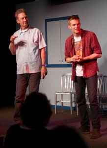 Ryan Stiles (L) creates a new scene on the spot with Tobias Childs (R) at the Upfront Theatre.