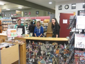 (From left) Volunteer Coordinator, Anna Larson, Manager, Dee Dee Chapman, and employee, Benjamin Owens, work hard to settle in at their new location in the Bellingham Public Market.