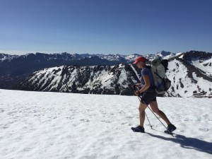 Nell crosses a snow field near Sonora Pass on her Pacific Crest Trail hike. Photo credit: Emily Barnett Highleyman.