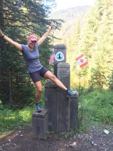 A triumphant Nell reaches the northern terminus of the PCT at the US-Canada border after hiking 2,650 miles. Photo courtesy: Nell Highleyman.
