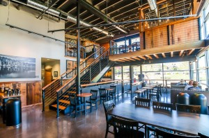 "The Barkley Village Woods also includes the second-story ""Greenhouse,"" a small meeting area that's free for customers to use. Several Woods locations offers similar spaces. Photo courtesy: The Woods Coffee."