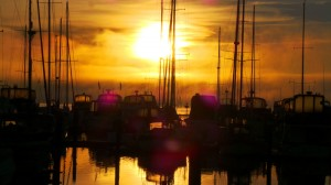 Semiahmoo Marina is surrounded on all sides by gorgeous water and mountain views. Stunning sunsets abound. Photo courtesy: Semiahmoo Marina.
