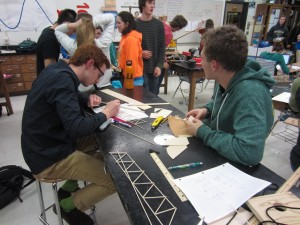 Students put last minute touches together the night before the regional Science Olympiad competition.