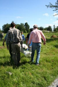 Moles' Brian Flowers assists a family with transport of their loved one to The Meadow using a muslin shroud. Photo courtesy: Brian Flowers.