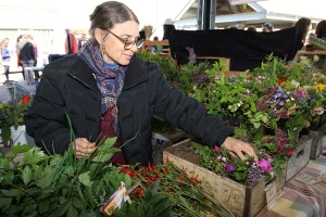 Beth, who has been vending at the Bellingham Farmers Market for more than 30 years, considers her booth a home away from home where she can meet and mingle with customers and other vendors.