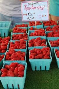 Fresh organic raspberries for sale at the Bellingham Farmers Market. Photo credit: Bellingham Whatcom County Tourism.