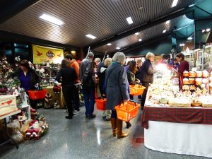 Customers peruse vendors at the Home for the Holidays show. Photo courtesy: Joyce Hill.