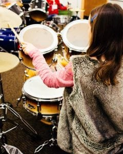 Girls practice on drums at the Bellingham Girls Rock Camp. Campers can list what instruments they prefer to work with when they register for camp. Photo credit: Kelsey Majors.