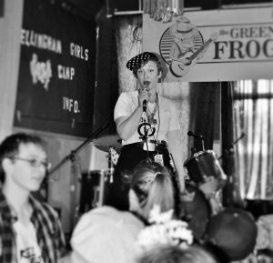 Morgan Paris Lanza sings on stage for a live performance at the Green Frog in Bellingham. The Bellingham Girls Rock Club has performed here in the past. Photo credit: Alycia Hendrickson.