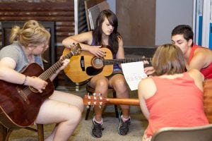 Girls and volunteers practice in group settings. Photo credit: Kevin Lowdon.