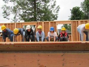 Habitat for Humanity utilizes teams of 10-12 people, such as the Women Build program, to construct the homes. Photo courtesy: Habitat for Humanity.