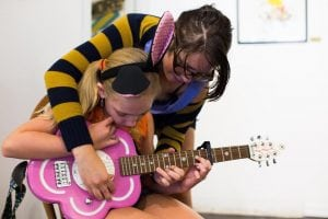 Although there can be up to 30 campers per session, individual learning time is critical at Bellingham Girls Rock Camp. Photo credit: Tommy Calderon.