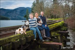 Mark Turner took this family portrait on the abandoned railroad trestle at the south end of Lake Whatcom. The family lives just up Blue Canyon Road and chose this location for the meaning it has to them. Photo credit: Mark Turner.