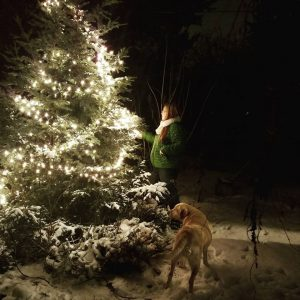 Molly Greenleaf captured this festive moment of her sister and her dog. Photo credit: Molly Greenleaf.