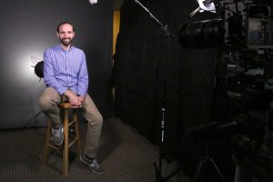 Josh Burdick films personal interviews for local businesses in his downtown studio. Photo credit: Theresa Golden.