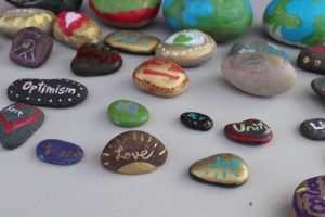 These hand-painted rocks were designed to uplift others. Photo courtesy: Celina Tate and the Bellingham Baha'i kids.