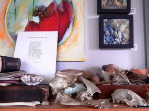 Canyon's collection of skulls inspires her paintings. She also writes poems and fiction. Photo credit: Patricia Herlevi.